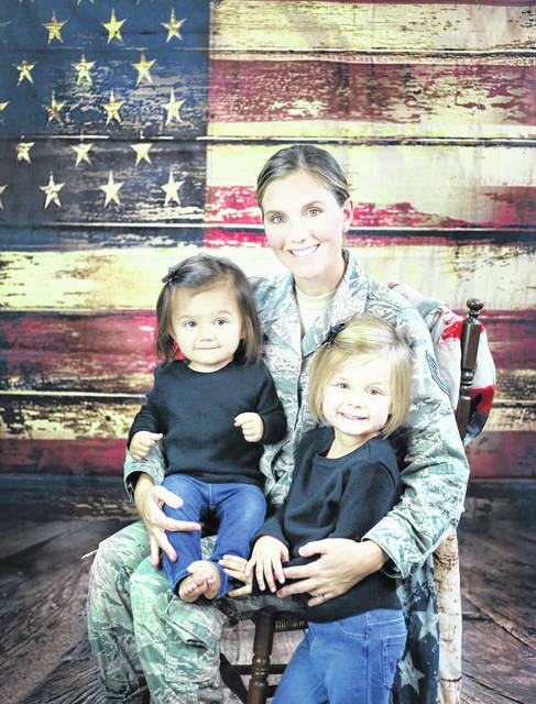 Catie (Wolfe) Cox is pictured with her daughters Carly and Calie before leaving for deployment earlier this fall.