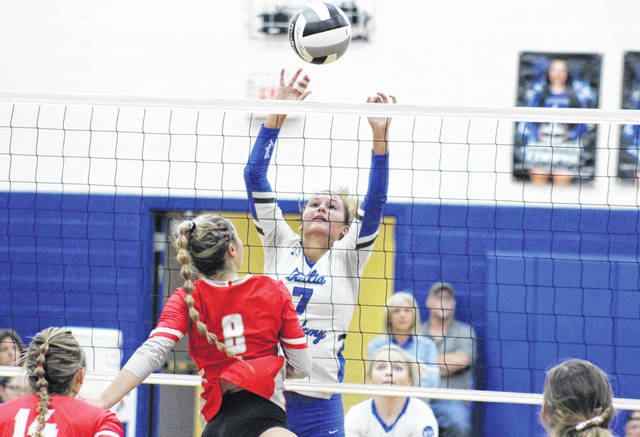 GAHS senior Peri Martin blocks a Sheridan spike attempt, during the Division II district semifinal on Oct. 23 in Londonderry, Ohio.