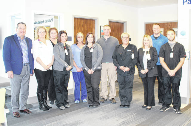Holzer staff and administrators were on hand Tuesday for the 5th anniversary celebration of the Holzer Meigs Emergency Department. Pictured (from left) are Holzer CEO Brent Saunders, manager Angee Arnold, Misty Bissell, Jessica Williams, Barb Triplett, Carli Johnson, physician Jay Rorrer, Kim Follrod, Chief Nursing Officer Lisa Detty, Jimmy Will and Brady Smith.