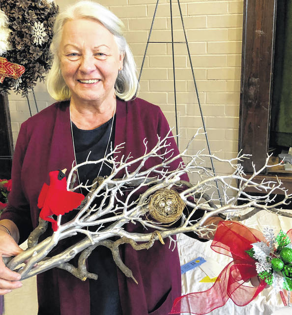 Linda Blosser received the Creativity Award at the 2018 Christmas Flower Show. She is pictured with a swag, one of her creative designs.