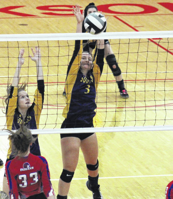 Southern senior Baylee Wolfe (3) blocks a Peebles spike attempt, alongside teammate Phoenix Cleland (left), during the Lady Tornadoes district semifinal victory on Oct. 24, in Jackson, Ohio.
