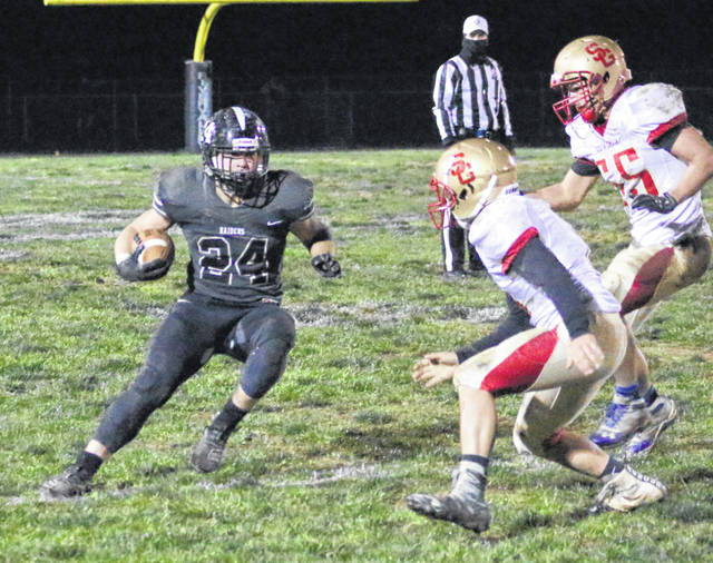 River Valley senior running back Cole Young (24) picks up yardage as he heads toward a pair of South Gallia defenders during a Nov. 1 football contest in Bidwell, Ohio.