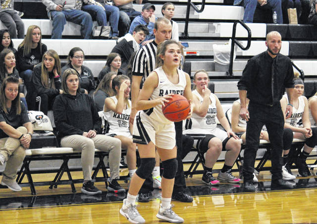RVHS sophomore Lauren Twyman lines up a shot from in front of the Lady Raider bench, during River Valley's 56-32 victory on Monday in Bidwell, Ohio.