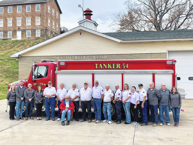 Representatives from Farmers Bank and the Chester Volunteer Fire Department are pictured with the new fire truck recently purchased by the department.
