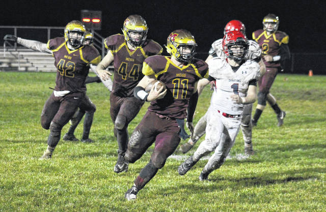 Meigs sophomore Jake McElroy (11) carries the ball for a gain during the Marauders' 30-7 victory over Alexander on Thursday in Rocksprings, Ohio.