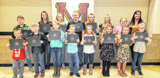 Meigs Local Students of the Month in attendance at the meeting are pictured with Student Achievement Liaison Heather Hawley.