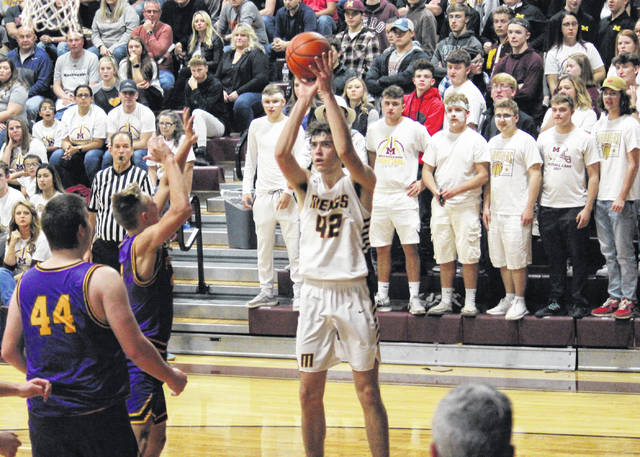 Meigs senior Bobby Musser (42) tries a two-pointer over Tornadoes Arrow Drummer (44) and Cole Steele (center), during the Marauders' 10-point victory on Friday at Larry R. Morrison Gymnasium in Rocksprings, Ohio.