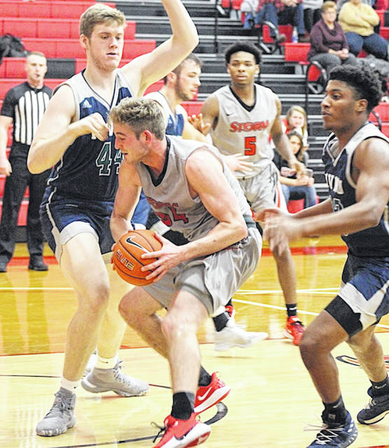 Rio Grande's Markus Geldenhuys attempts to put up a shot over Mount Vernon Nazarene's Ben Pollock during the second half of Tuesday night's 63-45 loss to the eighth-ranked Cougars at the Newt Oliver Arena.
