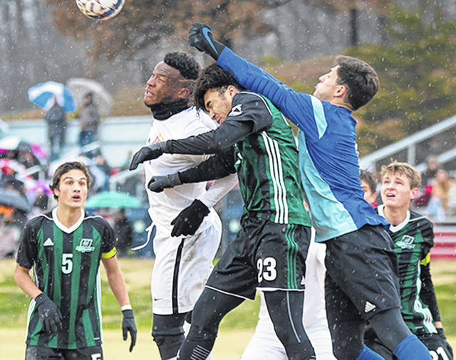 Rio Grande's Omar Walcott (white uniform) battles Huntington's Mario McLennon (23) and Gabe Greenfield (blue shirt) for control of the ball on a corner kick in the second half of Saturday's 1-0 win over the Foresters in the opening round of the NAIA Men's Soccer National Championship at Evan E. Davis Field. With the win, the RedStorm advance to the tourney's second round on Monday, Dec. 2, in Irvine, Calif.