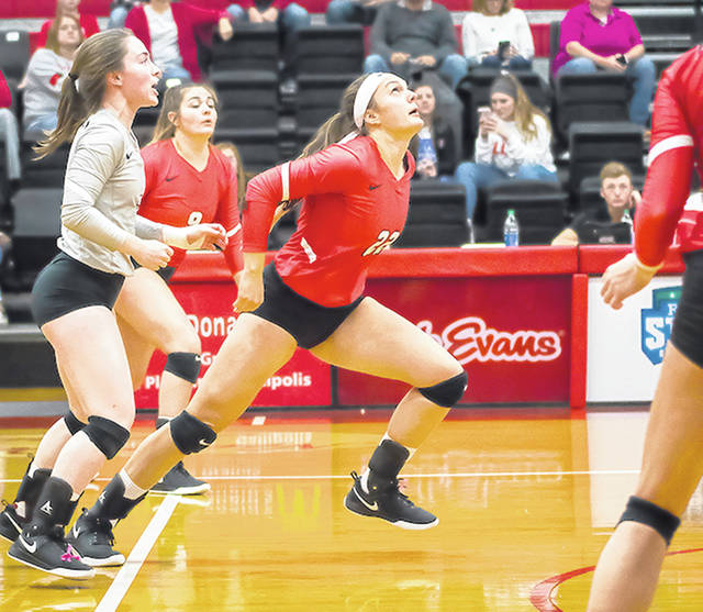 Rio Grande sophomore middle hitter Jess Youse, middle, prepares to leap for a spike attempt during a regular season match at Newt Oliver Arena in Rio Grande, Ohio.