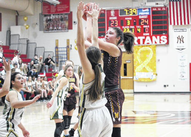 Meigs freshman Rylee Lisle (right) tries a contested two-pointer over Athens senior Laura Manderick, during the Lady Marauders' 51-43 victory in the TVC Turn it Gold Classic on Saturday at Alexander High School in Albany, Ohio.