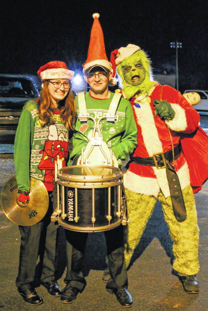 Molly Hill, Gage Carleton, The Grinch are pictured taking part in the Racine Christmas activities.