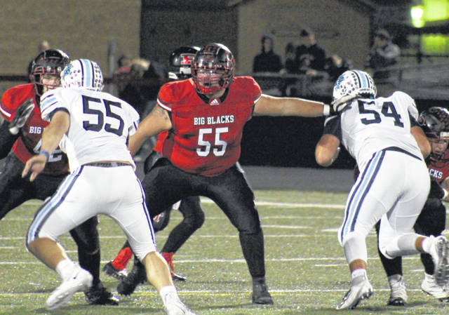 Point Pleasant senior Jacob Muncy (55 in red) helps out on a pair of blocks during a pass play in the Big Blacks' game against Louisville on Oct. 18 in Point Pleasant, W.Va.