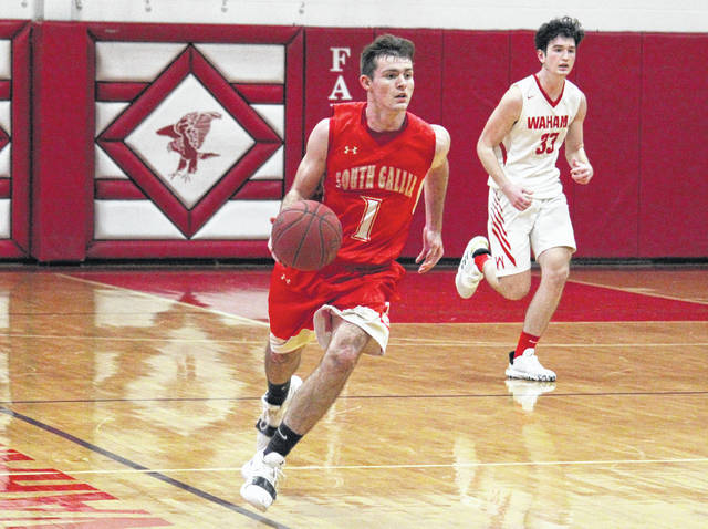 South Gallia senior Kyle Northup (1) leads a fast break in front of Wahama senior Adam Groves (33), during the Rebels' 60-23 triumph on Friday at Gary Clark Court in Mason, W.Va.