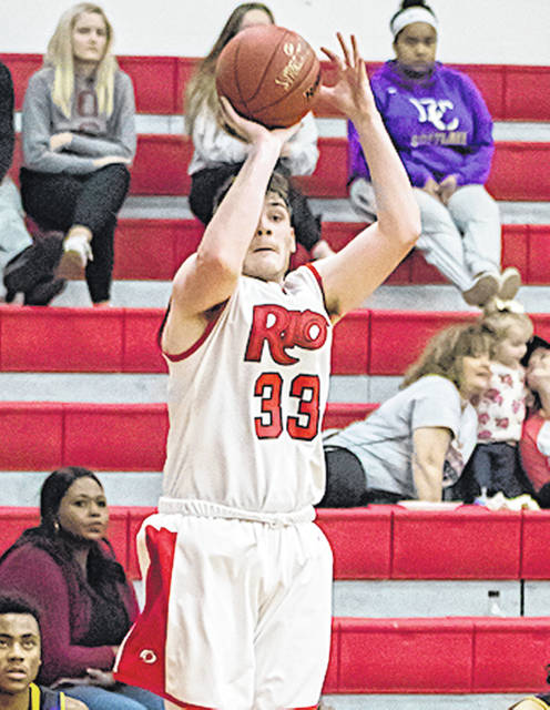 Rio Grande's Trey Kelley takes aim at one of the RedStorm's season-high 13 three-point goals in Saturday afternoon's 87-68 win over Carlow University at the Newt Oliver Arena.