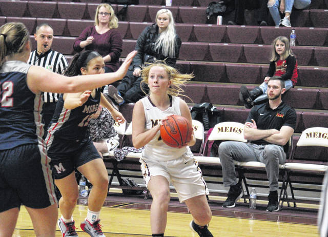 Meigs sophomore Meredith Cremeans pulls up for a shot, during the Lady Marauders' 90-40 setback on Wednesday in Rocksprings, Ohio.