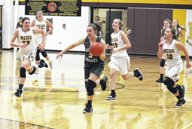 River Valley senior Payton Crabtree (3) leads a fast break in front of Lady Marauders Hannah Durst (33), Olivia Haggy (25) and Bre Lilly (10), during the Lady Raiders' 61-53 victory on Thursday in Rocksprings, Ohio.