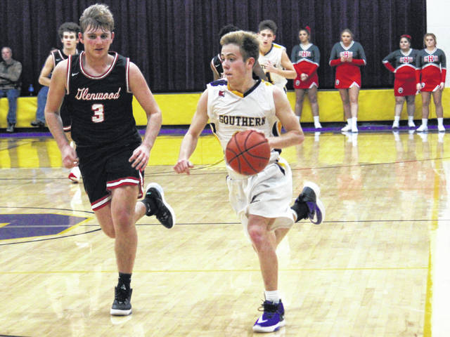 Southern senior Chase Bailey (right) drives to the basket in front of Glenwood's Tanner Voiers (3), during the Tigers' 60-47 victory on Friday in Racine, Ohio.