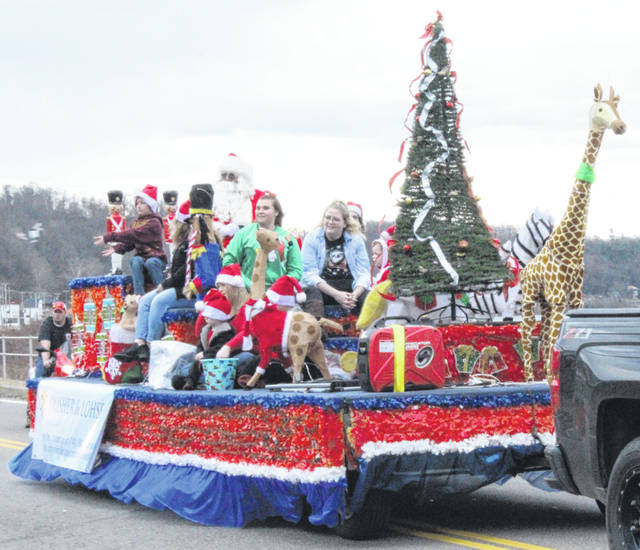 The annual Pomeroy Christmas Parade was held on Sunday afternoon in the downtown area with a visit from Santa. Santa rode through town on a float, while the Meigs band marched along the parade route playing seasonal favorites. More scenes from the parade appear inside today's edition and online at mydailysentinel.com.