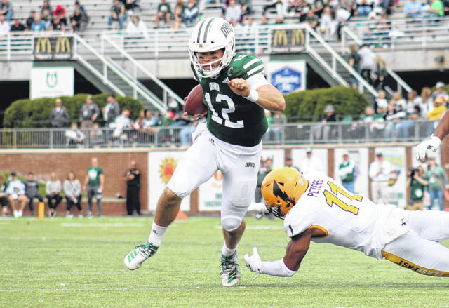 Ohio senior Nathan Rourke (12) evades a Kent State defender, during the Bobcats' Oct. 19 victory at Peden Stadium in Athens, Ohio.