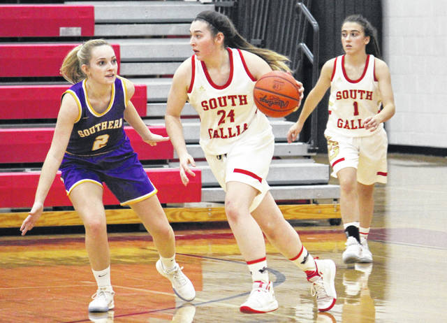 SGHS senior Christine Griffith (24), in front of teammate Alyssa Cremeens (1), drives past SHS senior Shelby Cleland (2), during the Lady Rebels' 50-39 victory on Thursday in Mercerville, Ohio.