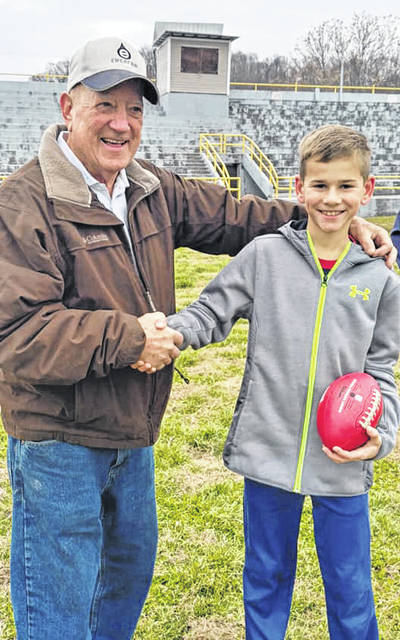 Richard Hovatter, 1957 Middlport alumnus, made the call heads or tails for the 2019 Middleport-Pomeroy Thanksgiving Day game. Nolan Blake, grandson of John Blake, Middleport alumus, tossed the coin with Middleport winner.