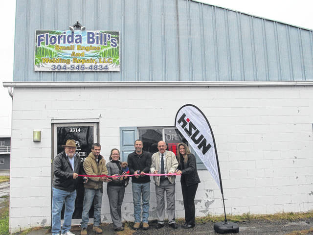"""A ribbon cutting was recently held for Florida Bill's Automotive Small Engine & Welding Repair, 3314 Mossman Avenue, Point Pleasant, W.Va. Reach Florida Bill's at 304-675-2002. Hours of operation are Monday-Friday, 8 a.m. - 5:30 p.m., Saturday, 8 a.m. - 2 p.m. Welcoming the new business were, from left, Larry Jones, Mason County Chamber of Commerce vice president, Wyatt Corson, Linda Curry with mascot Maxwell, William """"Bill"""" Corson, Mayor Brian Billings, City Clerk Amber Tatterson."""