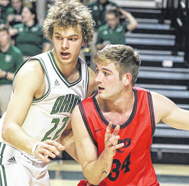 Rio Grande's Markus Geldenhuys attempts to move past Ohio's Nolan Foster during Wednesday night's meeting between the two schools at the Convocation Center in Athens, Ohio. The Bobcats defeated the RedStorm, 90-51.