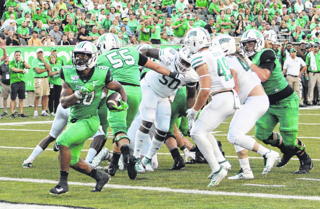 Marshall running back Brenden Knox (20) strolls into the endzone for a score during a Sept. 14, 2019, contest against Ohio University at Joan C. Edwards Stadium in Huntington, W.Va.