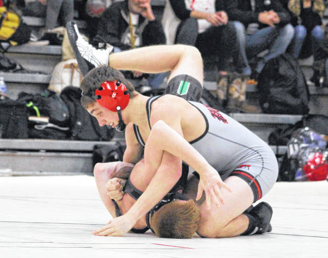 Point Pleasant sophomore Derek Raike maintains leverage on a Winfield opponent during a 132-pound match on Dec. 11, 2019, in Point Pleasant, W.Va.