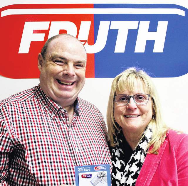 Pictured left to right, Chris Homer, winner of a $500 Fruth Gift Card, and Lynne Fruth, president of Fruth Pharmacy.