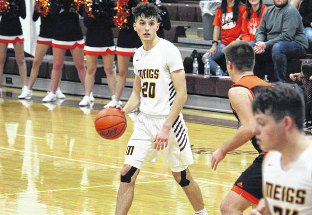 Meigs senior Weston Baer (20) brings the ball up court, during the Marauders' win non-conference game against Belpre on Dec. 3 in Rocksprings, Ohio.
