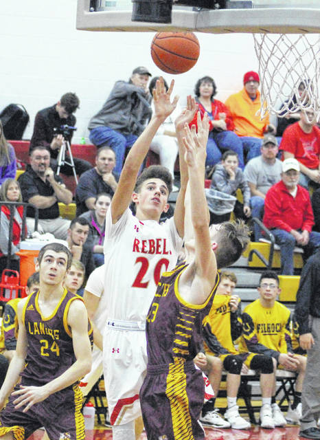 South Gallia sophomore Brayden Hammond (20) releases a shot attempt during the first half of Tuesday night's boys basketball game against Federal Hocking in Mercerville, Ohio.