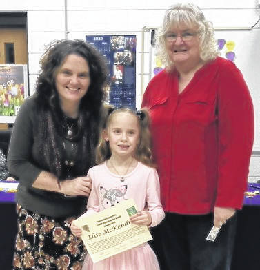 STORM Student of the Month Elise McKendree is pictured with Principal Tricia McNickle and Board President Brenda Johnson.
