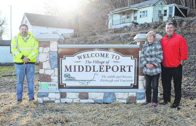 """A new """"Welcome to Middleport"""" sign has been placed at the entrance to the village coming from Pomeroy. Pictured are Village Administrator Joe Woodall, then Mayor Sandy Iannarelli and Home National Bank Vice President and Middleport Branch Manager Randy Pierce."""