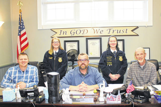 Racine Southern FFA officers Kristin McKay and Raeven Reedy are pictured with Meigs County Commissioners Jimmy Will, Randy Smith and Tim Ihle during the recent Commissioner meeting.