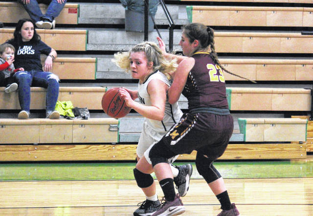 Eastern freshman Juli Durst drives past Meigs junior Jerrica Smith (23), during the first half of the Lady Eagles' 53-37 victory on Monday in Tuppers Plains, Ohio.