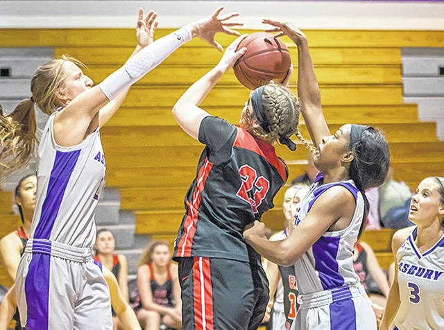 Rio Grande's Lexi Woods muscles up a shot between two Asbury defenders during Tuesday night's 103-93 win over the Eagles in Wilmore, Ky. Woods finished with a career-best 34 points and 14 rebounds in the victory.