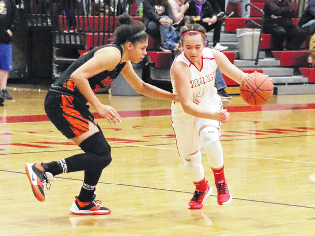 Wahama senior Hannah Rose, right, dribbles past a Belpre defender during a Dec. 5, 2019, girls basketball game in Mason, W.Va.