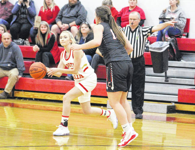 South Gallia junior Kennedey Lambert releases a bounce pass during the first half of Thursday night's girls basketball game against Trimble in Mercerville, Ohio.
