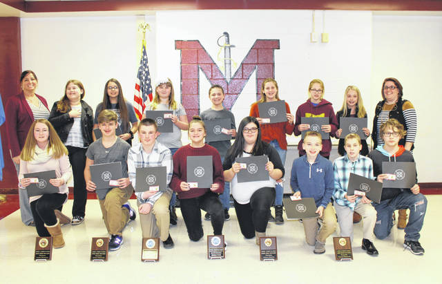 Meigs Middle School Model UN team members were recognized during the Meigs Local Board of Education Meeting. Team members in attendance are pictured with Board Student Achievement Liaison Heather Hawley and Model UN advisor Sarah Lee.