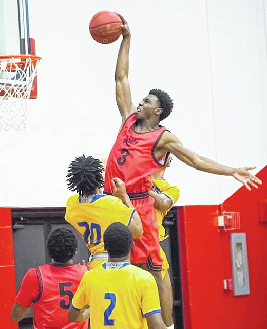 Rio Grande's Dwaine Simmons goes airborne for a second half dunk during Saturday afternoon's 79-54 River States Conference win over Midway University at the Newt Oliver Arena.