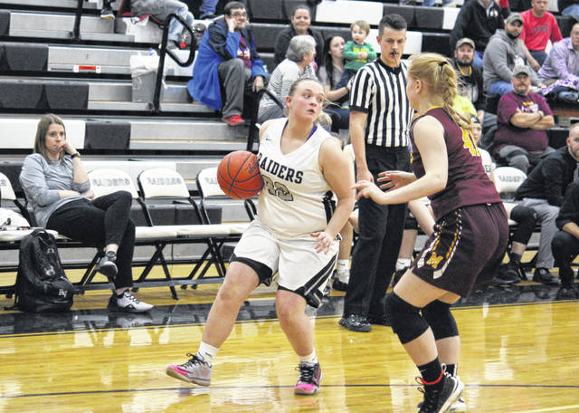 River Valley senior Kaylee Tucker looks to pass around Meigs sophomore Meredith Cremeans (right), during the Lady Raiders' 10-point victory on Monday in Bidwell, Ohio.