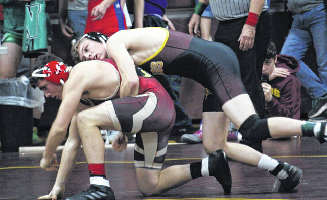 Meigs senior Tucker Smith (right) takes the back of South Gallia senior Jared Ward (left), during the Meigs Invitational on Saturday in Rocksprings, Ohio.