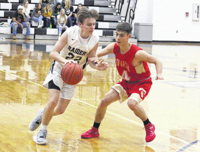 River Valley sophomore Mason Rhodes (22) dribbles past South Gallia defender Andrew Small (14) during the second half of Saturday night's boys basketball contest in Bidwell, Ohio.