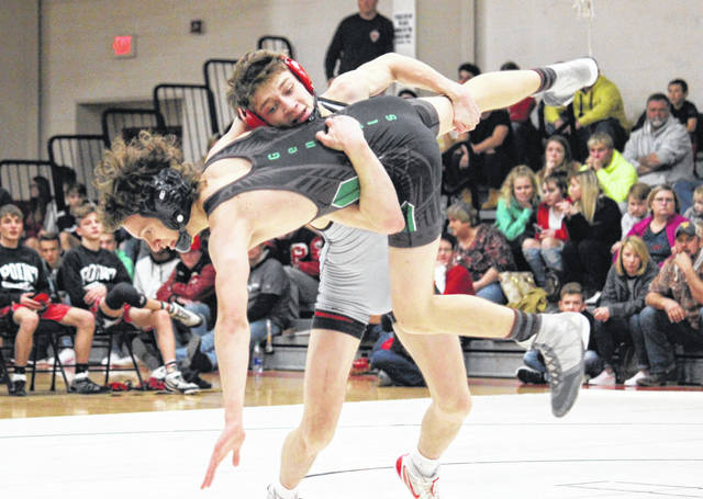 Point Pleasant junior Isaac Short gains leverage on a Winfield opponent during a 120-pound match held on Dec. 11, 2019, in Point Pleasant, W.Va.
