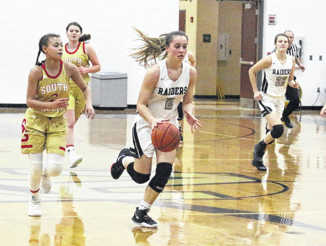 River Valley junior Hannah Jacks (2) leads a fast break during the first half of Monday night's girls basketball contest against South Gallia in Bidwell, Ohio.