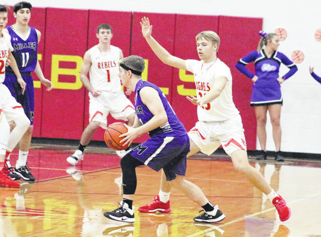 South Gallia sophomore Tristan Saber (23) applies pressure to a Miller player during the first half of Tuesday night's boys basketball contest in Mercerville, Ohio.