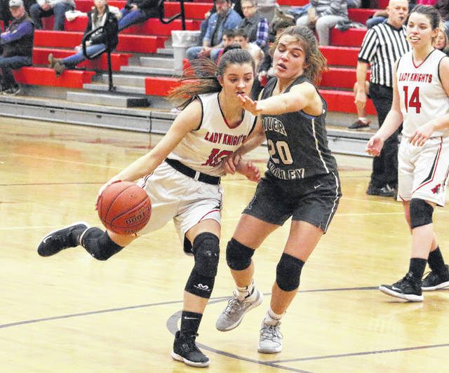 River Valley sophomore Lauren Twyman (20) guards Point Pleasant sophomore Brooke Warner (10) during the second half of Thursday night's girls basketball game in Point Pleasant, W.Va.