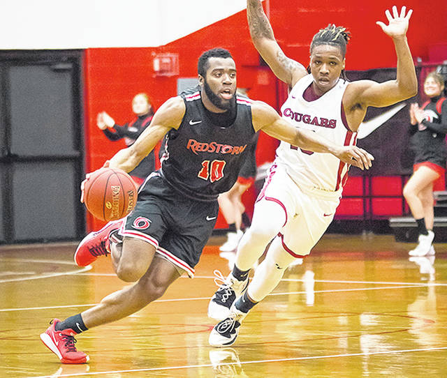 Rio Grande's Hadith Tiggs (10) drives past an Indiana University Kokomo defender during Thursday night's game at the Newt Oliver Arena. The 12th-ranked Cougars pulled away late for a 67-57 win over the RedStorm.